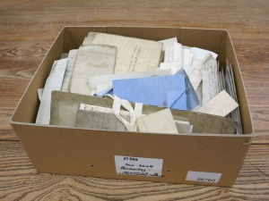 Picture of loose papes from the bottom of one of the Ponsonby family deed boxes