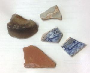 Non-Roman ceramics: Note soot on medieval pot base (top left)