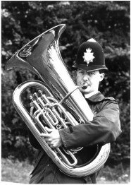 Image of police officer playing a tuba
