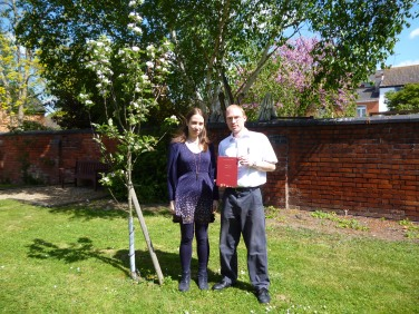 Jenny and Ant next to an apple tree in the Archives' garden