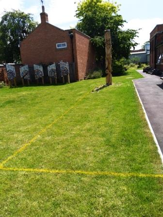 Image of One of four borders marked out to be dug out for plants
